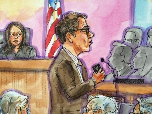 Samsung attorney John Quinn holds a smartphone as he makes his opening statement in the San Jose federal courthouse on April 1, 2014