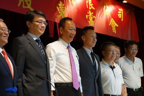 Foxconn CEO Terry Gou with other execs.