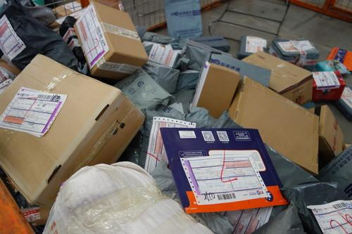 Packages at the YTO Express shipping center in Shanghai.