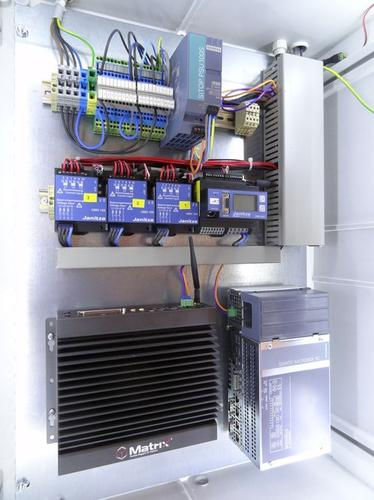 A mock-up of the monitoring equipment installed in two Westfalen Weser Energie secondary substations, showing the additional measuring devices (center) and industrial PCs from two vendors (bottom) used for collating and communicating the measurements.