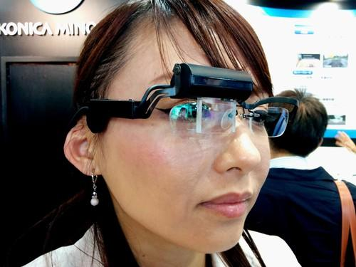 Konica Minolta showed off prototype smart glasses at Ceatec 2014 that incorporate holographic technology to project full-color graphics on a thin transparent lens.