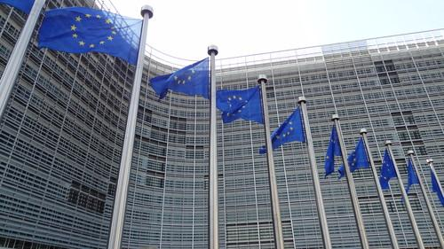 Flags in front of the European Commission headquarters in Brussels on June 17, 2015