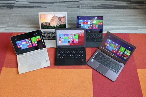 Lenovo's new LaVie enters the 13-inch club (center) which includes HP's Envy X360 (left front) Asus' UX305 (right front) Apple's Mac Book Air 13 2015 (rear left) and Dell's XPS 13 2015 with QHD+ touch screen.