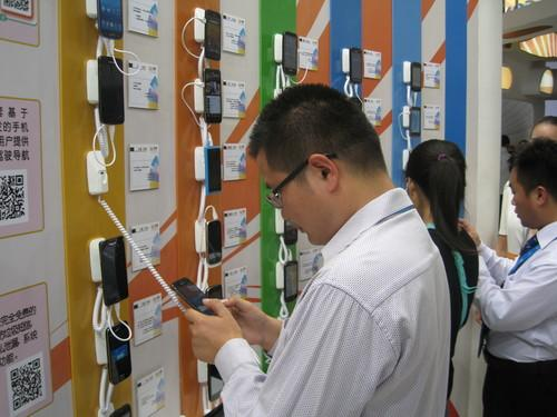 Smartphones are displayed at an electronics show in Beijing