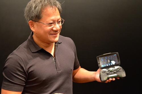 CEO Jen-Hsun Huang shows Nvidia's Shield gaming device at Computex