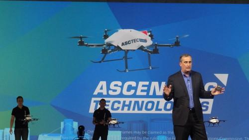 Intel CEO Brian Krzanich with drones floating around during CES 2015 keynote