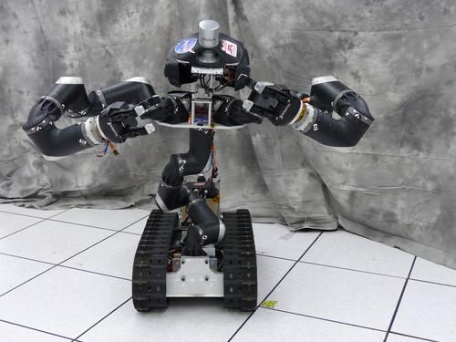 NASA's Surge robot has a flexible spine and grippers. It could be used in tight spots such as crippled nuclear power plants.