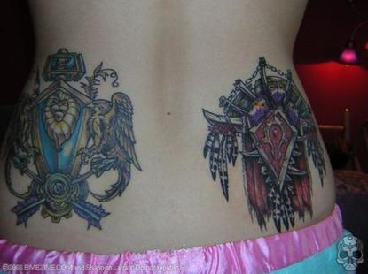 An overzealous WoW player shows off her Alliance and Horde tattoos. Presumably, she'll be first in line for the new expansion.