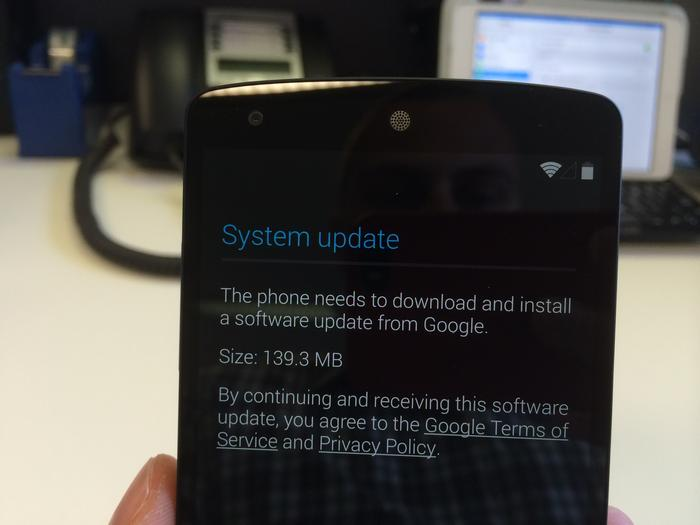 You'll need to download and install a system update before you can use the Nexus 5.