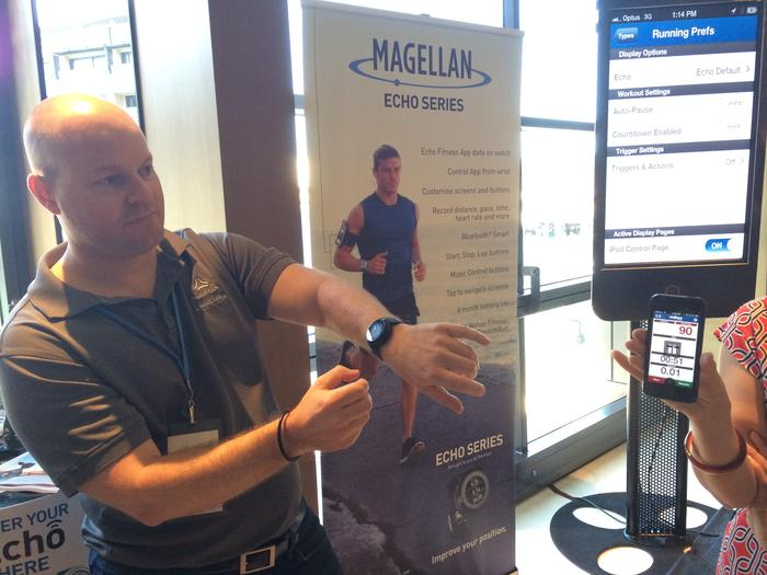 Magellan's national sales manager, Paul Saussey, demonstrates the Echo smartwatch at a media event in Sydney.