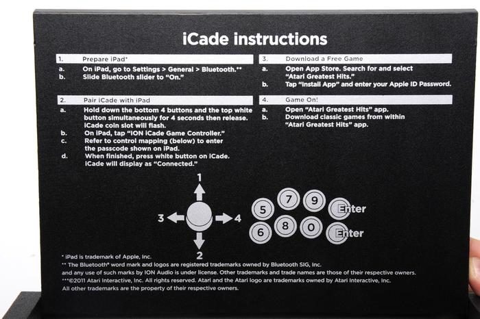 The iCade's Bluetooth pairing instructions are printed underneath the folding lid if you forget them.