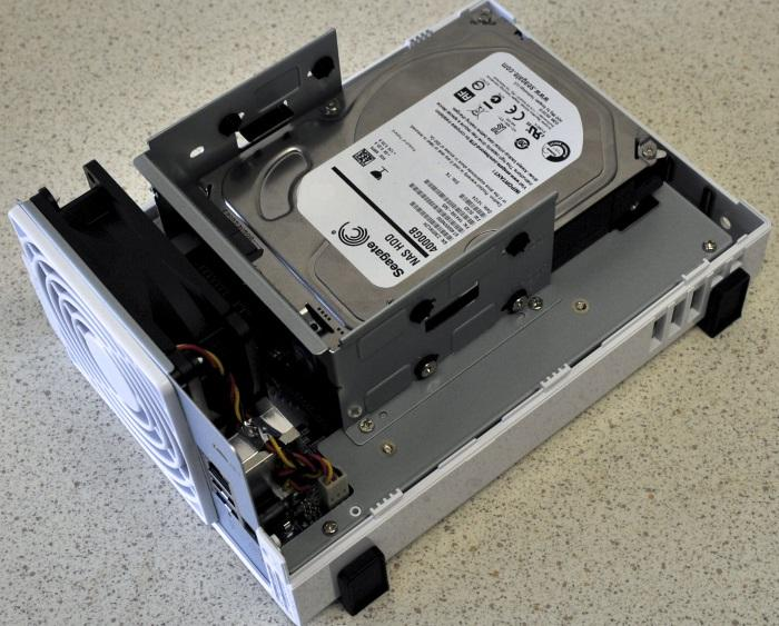 Installing the hard drives involves separating the DiskStation to access the internal drive bays.